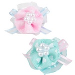 Faux pearls centers and heart ribbon add plenty of frill.